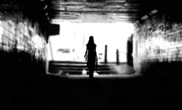 Back of a Woman Silhouette in a Tunnel Royalty Free Stock Photography