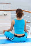 Back of woman sitting on cruise liner deck Stock Image