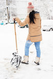Back of woman take a break from shoveling Stock Photography