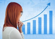 Back of woman thinking against blue graph. Digital composite of Back of woman thinking against blue graph Royalty Free Stock Image