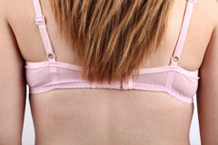 A back of woman wearing pink  bra Stock Photography