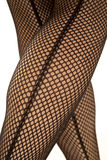 Back of womans legs in fishnet crossed Royalty Free Stock Image