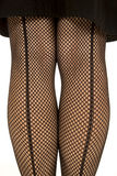 Back of womans legs in fishnet stand Stock Photography