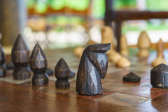 Back wooden chess on chess board Royalty Free Stock Photo