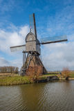 Back of a wooden hollow post mill in the Netherlands Stock Photo