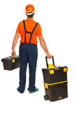 Back of worker walking Royalty Free Stock Photos