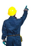Back of worker woman pointing up. Isolated on white background Royalty Free Stock Image