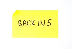 'Back In 5' written on a sticky note Stock Images