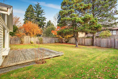 Back yard with deck and grass. Stock Image