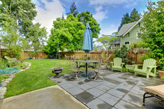Back yard fenced with furniture and sitting area. Stock Photos