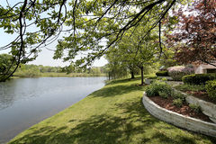 Back yard and lake. Of luxury suburban home Stock Photos