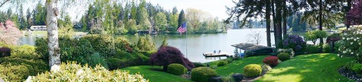 Back yard landscape with lake. Royalty Free Stock Photo