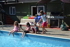 Back yard pool party Royalty Free Stock Image
