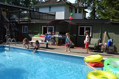 Back yard pool party Royalty Free Stock Photos