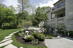 Back yard with stone patio. Back yard and patio with stone steps Royalty Free Stock Photography