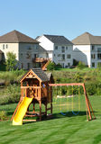Back Yard Wooden Swing Set. On Green Lawn,vertical stock photo