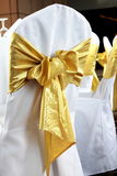 Back of yellow and gold wedding chairs Royalty Free Stock Images