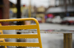 Back of a yellow outdoor chair in a street cafe on Mercer street Royalty Free Stock Images