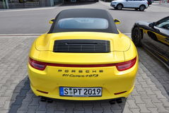 Back of Yellow Porsche 911 Carrera 4 GTS Stock Image