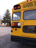 Back of a yellow school bus. Back view of a yellow school bus stock photo