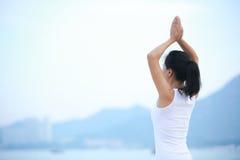 Yoga woman seaside Royalty Free Stock Images