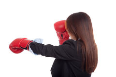Back of young Asian businesswoman with boxing glove Royalty Free Stock Image