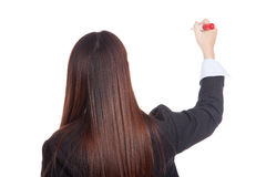 Back of young Asian businesswoman write with red marker Royalty Free Stock Photos