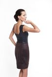 Back of Young beautiful sexy woman in brown skirt Stock Photography