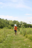 Back of young boy on walking trail Stock Photos