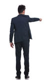 Back of a young business man pointing his finger Royalty Free Stock Images