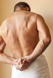 Back of young Caucasian man with white towel Royalty Free Stock Images