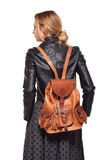 Back of a young girl dressed in leather jacket with brown leathe Royalty Free Stock Images
