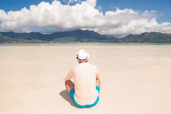 Back  of a young man  resting on the beach Royalty Free Stock Photography