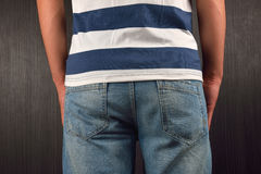 Back of young man wearing white t-shirt with blue stripes, stand Royalty Free Stock Photos