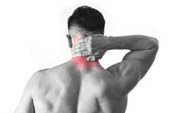 Back young muscular sport man holding sore neck touching massaging cervical area Stock Photos