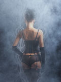 Back of a young and sexy woman in retro lingerie Royalty Free Stock Photo