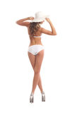 Back of a young woman posing in a white swimsuit Stock Photo