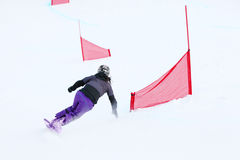 Back of young woman riding snowboard Stock Images