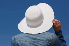 Back of a young woman with sun hat Royalty Free Stock Photo