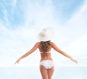 Back of a young woman in a white swimsuit Stock Photography