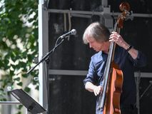 Backa Hans Eriksson on double bass. Norrkoping, Sweden - June 6, 2018: Backa Hans Eriksson playing double bass during a much-appreciated free public concert royalty free stock images