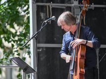 Backa Hans Eriksson on double bass. Norrkoping, Sweden - June 6, 2018: Backa Hans Eriksson playing double bass during a much-appreciated free public concert stock photography
