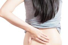 Backache или тягостная талия в женщине изолированной на белой предпосылке Путь клиппирования на белой предпосылке стоковое фото