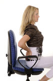 Backache. Young blond woman has backache Royalty Free Stock Photos