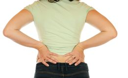 Backache. Young slim female has backache Stock Image