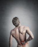 Backache. Young boy felt back pain royalty free stock photos