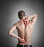 Backache. A boy felt back pain stock photos
