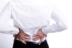 Backache ,businessman hand bending lower back Stock Images