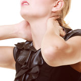 Backache. Closeup of woman suffering from back pain Royalty Free Stock Photography