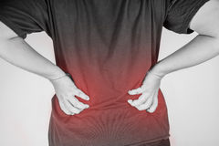 Backache injury in humans .backache pain,joint pains people medical, mono tone highlight at backache Stock Photos